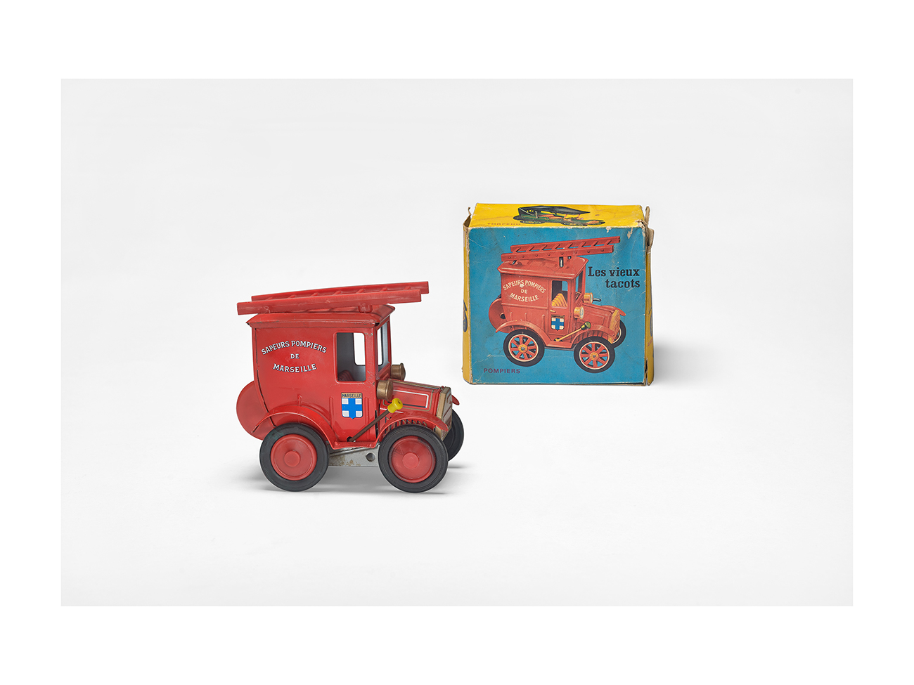 """Marseille fire brigade's old bangers"", Wamoo manufacture, 1960s. Toy in lithographed sheet metal, plastic, cardboard box. Massilia Toy, Marseille © Yves Inchiermann"